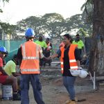 7am Toolbox meeting for workers. Salote Bete, HR Manager greeting workers early morning.