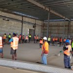 Salote Bete, HR Manager (Centre) with workers on the FNPF site for Nadi Retail Development. A current project of Pacific Building Solutions.