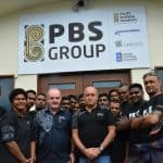 Simon Ahearn, PBS Group General Manager standing front left with Michael Fairfax, Managing Director PBS Group with Workshop staff at their Headquarters in Lami, Suva.